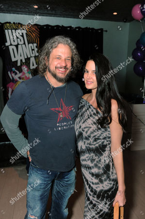 Joe Reitman, left, and a guest attend the Just Dance 4 launch party hosted by Ashley Benson and Christina Milian on in Los Angeles. Just Dance 4 hits store shelves on Tuesday, Oct. 9, 2012.Â