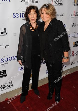 "Lily Tomlin, left, and Linda Bloodworth-Thomason arrive at the Premiere of ""Bridegroom"" at The Samuel Goldwyn Theatre on in Beverly Hills, Calif"