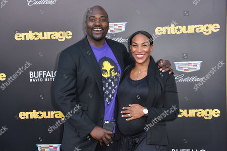 """Marcellus Wiley, left and Jazmin Lopez arrive at the LA Premiere Of """"Entourage"""" at the Regency Village Theatre, in Los Angeles"""
