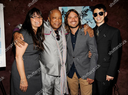 "Quincy Jones, second from left, a producer of the documentary film ""Keep On Keepin' On,"" poses with fellow producer Paula DuPre' Pesmen, far left, director Al Hicks, second from right, and pianist Justin Kauflin at the premiere of the film at Landmark Theatres, in Los Angeles. The film depicts legendary jazz trumpeter Clark Terry and his friendship with Kaufllin, a blind, 23-year-old piano prodigy"