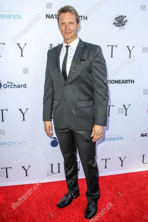 Stock Photo of Shaun Monson attends the world premiere of 'UNITY' at the DGA Theater on in Los Angeles