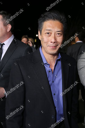 """Producer Francois Chau arrives at the LA premiere of """"21 and Over"""" at the Westwood Village Theatre on in Los Angeles"""