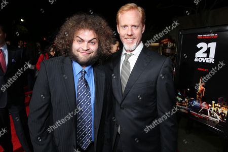 "Dustin Ybarra and Director/Writer Scott Moore arrive at the LA premiere of ""21 and Over"" at the Westwood Village Theatre on in Los Angeles"