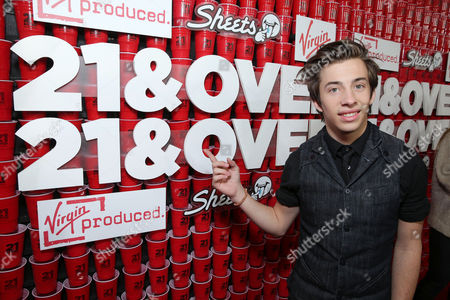 "Jimmy Bennett arrives at the LA premiere of ""21 and Over"" at the Westwood Village Theatre on in Los Angeles"