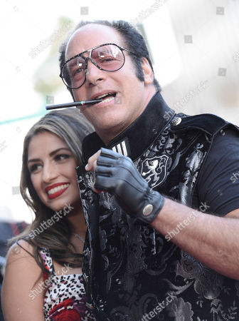 "Actor and comedian Andrew Dice Clay, right, and his wife Valerie Vasquez arrive at the LA Premiere of ""Blue Jasmine"" at the Academy of Motion Pictures Arts and Sciences on in Los Angeles"