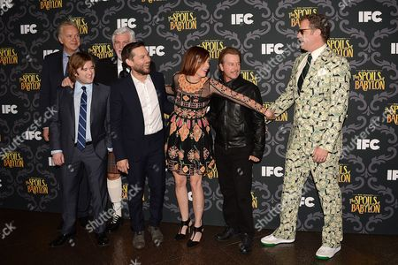 """From left, Tim Robbins, Haley Joel Osment, Steve Tom, Tobey Maguire, Kristen Wiig, David Spade and Will Ferrell arrive at the LA Premiere screening of """"The Spoils of Babylon"""" at the DGA Theater on Tueday, in Los Angeles"""