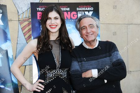 """Actress Alexandra Daddario, left, and director Joe Dante arrive at a special screening of """"Burying the Ex"""" held at Grauman's Egyptian Theatre, in Los Angeles"""
