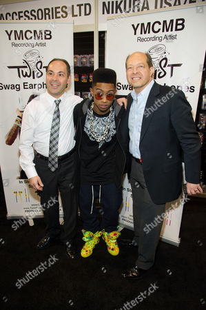 "The Mosseri family pictured with Hip hop artist, ""Lil Twist"" seen at International CES 2013, on in Las Vegas, NV for the debut of his new headphone collection ""Twist Swag Headphones by Nikura USA"