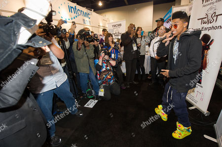 "Hip hop artist, ""Lil Twist"" seen at the International CES 2013, on in Las Vegas, NV for the debut of his new headphone collection ""Twist Swag Headphones by Nikura USA"