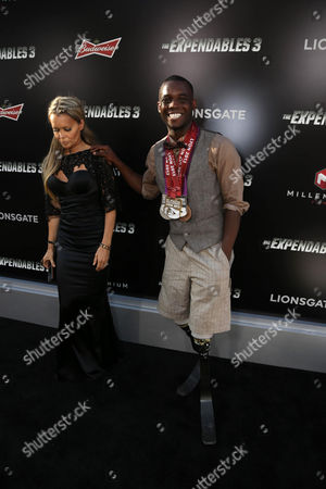"Olympic blade runner Blake Leeper arrives at the Lionsgate Los Angeles premiere of ""The Expendables 3"" at TCL Chinese Theatre, in Hollywood, Calif"