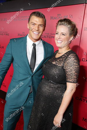 Alan Ritchson, left, and Catherine Ritchson seen at Lionsgate's 'The Hunger Games: Catching Fire' Los Angeles Premiere, on Monday, Nov, 18, 2013 in Los Angeles