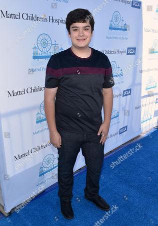 Devan Leos attends the Mattel Party on the Pier, in Santa Monica, Calif