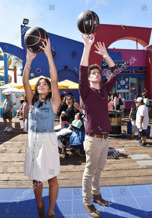 Ana Villafane, left, and Ben Winchell attend the Mattel Party on the Pier, in Santa Monica, Calif
