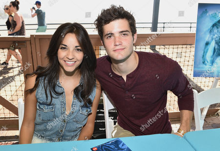 Ana Villafane, left, and Ben Winchell sign autographs at the Mattel Party on the Pier, in Santa Monica, Calif