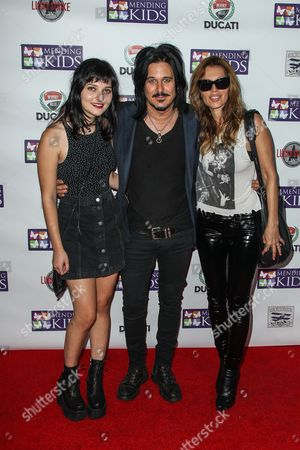 "From left, Frankie Clarke, Gilby Clarke and Daniella Clarke attend the ""Music On A Mission"" benefit concert held at Lucky Strike Live - Hollywood on in Los Angeles"