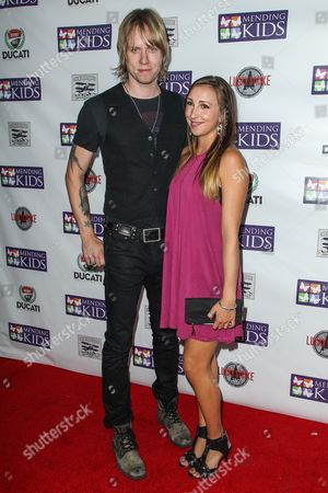 """Bryce Soderberg, left, and Ashley Edner attend the """"Music On A Mission"""" benefit concert held at Lucky Strike Live - Hollywood on in Los Angeles"""