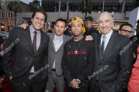 """Jonathan Glickman, President of the Motion Picture Group for Metro-Goldwyn-Mayer Studios, Adam Rosenberg, EVP of Production for Metro-Goldwyn-Mayer Studios, Tyga and Gary Barber, Chairman and Chief Executive Officer of Metro-Goldwyn-Mayer Inc., seen at Metro Goldwyn Mayer and New Line Cinema Premiere of """"Barbershop: The Next Cut"""" at TCL Chinese Theatre, in Hollywood"""