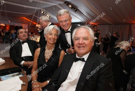 IMF Managing Director Christine Lagarde left, Chairman & CEO Hennessy Bernard Peillon center and Chairman and CEO, Moet Hennessy Christophe Navarre are seen at the Moet Hennessy Celebration of the Hermione Voyage 2015 at George Washington's Mount Vernon, in Mount Vernon, Va
