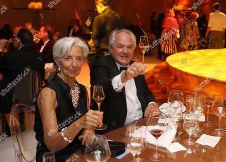 IMF Managing Director Christine Lagarde and Chairman and CEO, Moet Hennessy Christophe Navarre are seen making a toast at the Moet Hennessy Celebration of the Hermione Voyage 2015 at George Washington's Mount Vernon, in Mount Vernon, Va
