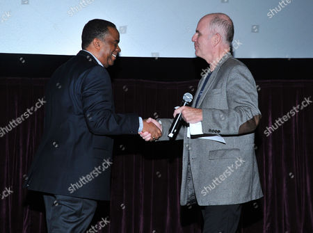 California state director of AARP George Davis, left, and host Bill Newcott attend AARP's Movies for Grownups Film Festival on at Regal Cinemas at L.A. LIVE in Los Angeles