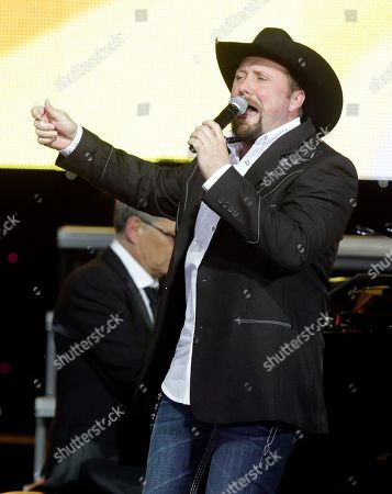Stock Image of Tate Stevens performs at Muhammad Ali's Celebrity Fight Night XIX at the JW Marriott Desert Ridge Resort and Spa on in Phoenix, Ariz
