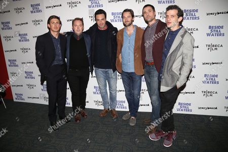 "Stock Image of From left, filmmaker Chris Lowell, Beck Bennett, Reid Scott, Ryan Eggold, Brett Dalton and Will Brill attend the premiere of ""Beside Still Waters"" at the Sunshine Landmark Theater, in New York"