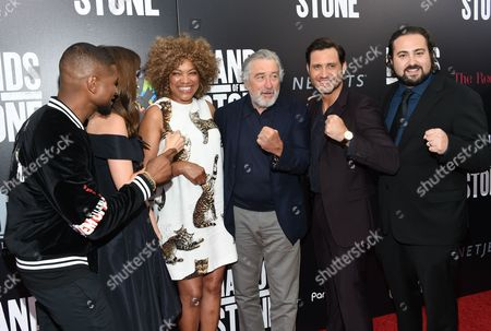"""Stock Picture of Actor Usher Raymond, left, actor Ana De Armas, Grace Hightower, actor Robert De Niro, actor Edgar Ramirez and director Jonathan Jakubowicz pose together at the U.S. premiere of """"Hands of Stone"""" at the SVA Theatre, in New York"""
