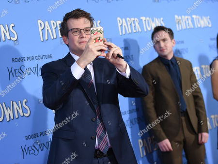 """Author John Green, left, and director Jake Schreier attend the premiere of """"Paper Towns"""" at AMC Loews Lincoln Square, in New York"""