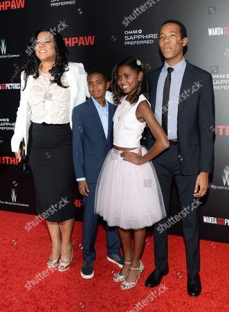 """Stock Photo of Lela Fuqua, left, Brando Fuqua, Asia Fuqua and Zachary Fuqua attend the premiere of """"Southpaw"""" at the AMC Loews Lincoln Square, in New York"""