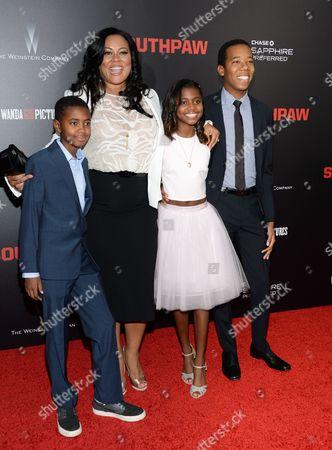 """Stock Picture of Brando Fuqua, left, Lela Fuqua, Asia Fuqua and Zachary Fuqua attend the premiere of """"Southpaw"""" at the AMC Loews Lincoln Square, in New York"""