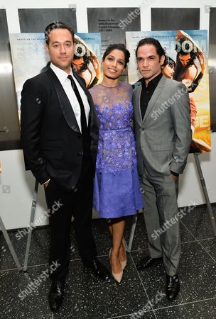 "Director Richard Raymond, left, actress Freida Pinto and actor Reece Ritchie attend a special screening of ""Desert Dancer"", hosted by The Cinema Society, at The Museum of Modern Art, in New York"