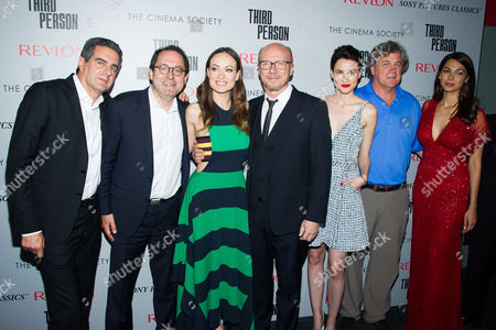 """Michael Nozik, left, Michael Barker, Olivia Wilde, Paul Haggis, Loan Chabanol, Tom Bernard and Moran Atias attend a screening of """"Third Person"""" hosted by the Cinema Society and Revlon on in New York"""