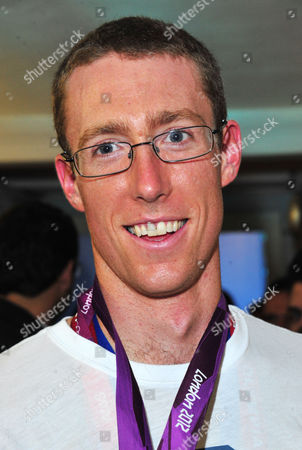 Charlie Cole poses at OMEGA House presents Olympic Swimmers Attend at OMEGA House on in London