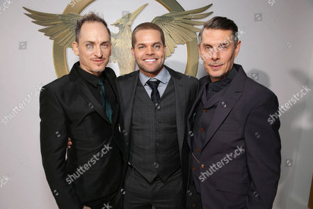 "Costume designer Bart Mueller, Wes Chatham and Costume designer Kurt Swanson seen at the Los Angeles Premiere of Lionsgate's ""The Hunger Games: Mockingjay - Part 1"" held at Nokia Theater L.A. Live, in Los Angeles"