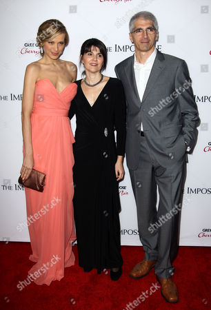 """Producer Maria Belon, center, model Petra Nemcova, left, and Enrique Alvarez pose together at the premiere of """"The Impossible"""" at the Arclight Cinerama Dome, in Los Angeles"""