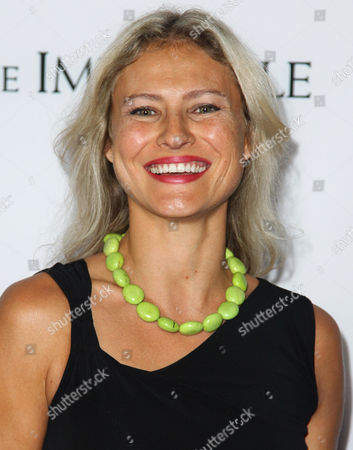 "Lana Antonova attends the premiere of ""The Impossible"" at the Arclight Cinerama Dome, in Los Angeles"