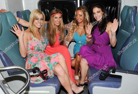"""Stock Image of Chanel Omari The cast of Bravo's """"Princesses: Long Island"""", from left, Casey Cohen, Chanel """"Coco"""" Omari, Amanda Bertoncini and Joey Lauren pose together at Penn Station before they depart for The Hamptons on in New York"""