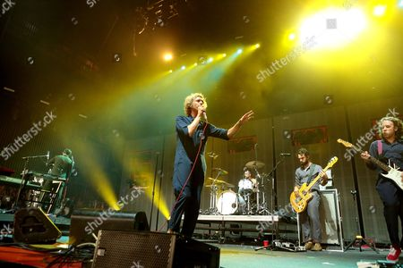 Aaron Bruno, from left, Isaac Carpenter, Marc Walloch, and Zach Irons of the band AWOLNATION perform in concert during the Radio 104.5 9th Birthday Show at BB&T Pavilion, in Camden, N.J