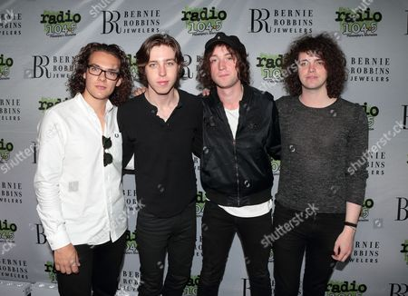 Bob Hall, from left, Van McCann, Johnny Bond and Benji Blakeway of the band Catfish and the Bottlemen pose for photographers backstage during the Radio 104.5 9th Birthday Show at BB&T Pavilion, in Camden, N.J