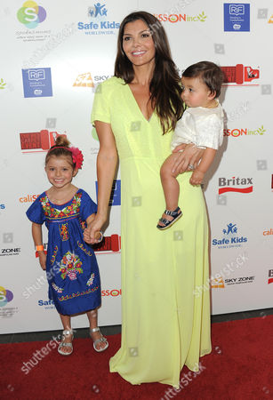 Ali Landry, her son Marcelo Alejandro Monteverde and daughter Estela Ines Monteverde attend the 2nd Annual Red CARpet event at the SLS Hotel on in Beverly Hills, Calif