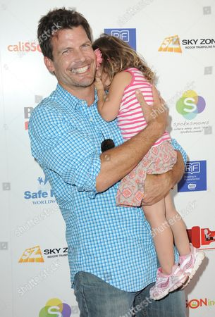 Stock Photo of Mark Deklin attends the 2nd Annual Red CARpet event at the SLS Hotel on in Beverly Hills, Calif