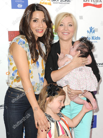 Marla Sokoloff Elliotte, Anne Puro, Jennifer Aspen and her daughter Charlotte Sofia O'Donnell attend the 2nd Annual Red CARpet event at the SLS Hotel on in Beverly Hills, Calif