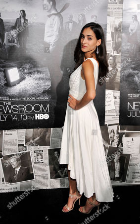 """Cherie Daly, a cast member in """"The Newsroom,"""" poses at the season 2 premiere of the HBO series at the Paramount Theater on in Los Angeles"""