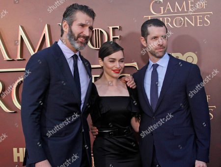 """Emilia Clarke, center, poses with the creators and executive producers of """"Game of Thrones,"""" David Benioff, left, and Dan Weiss seen at the season 5 premier at the War Memorial Opera House, Monday, March, 23, 2015, in San Francisco"""