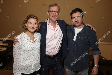 """Producers Meredith Stiehm, Alex Gansa and Alex Cary, of """"Homeland,"""" seen at Showtime's 2014 Summer TCA at the Beverly Hilton Hotel, in Beverly Hills, Calif"""
