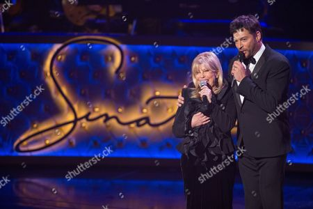 Nancy Sinatra and Harry Connick Jr. perform during the Sinatra 100 - An All-Star Grammy concert at The Wynn Las Vegas