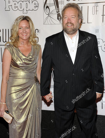 Don Schlitz and wife arrive at the 2012 Songwriters Hall of Fame induction and awards gala at the Marriott Marquis Hotel, in New York