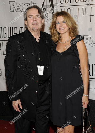 Songwriter Jimmy Webb and wife Laura Savini arrive at the 2012 Songwriters Hall of Fame induction and awards gala at the Marriott Marquis Hotel, in New York