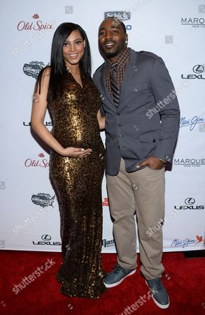 Ariel Meredith, left, and Hakeem Nicks attends Sports Illustrated's Swimsuit Issue 2015 Celebration at Marquee, In New York