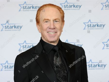 "Alan Kalter is seen walking the red carpet at the Starkey Hearing Foundation's 2013 ""So the World May Hear"" Awards Gala, on in St. Paul, Minn"
